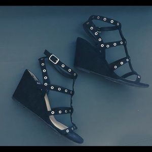 Black wedge sandals with silver grommets